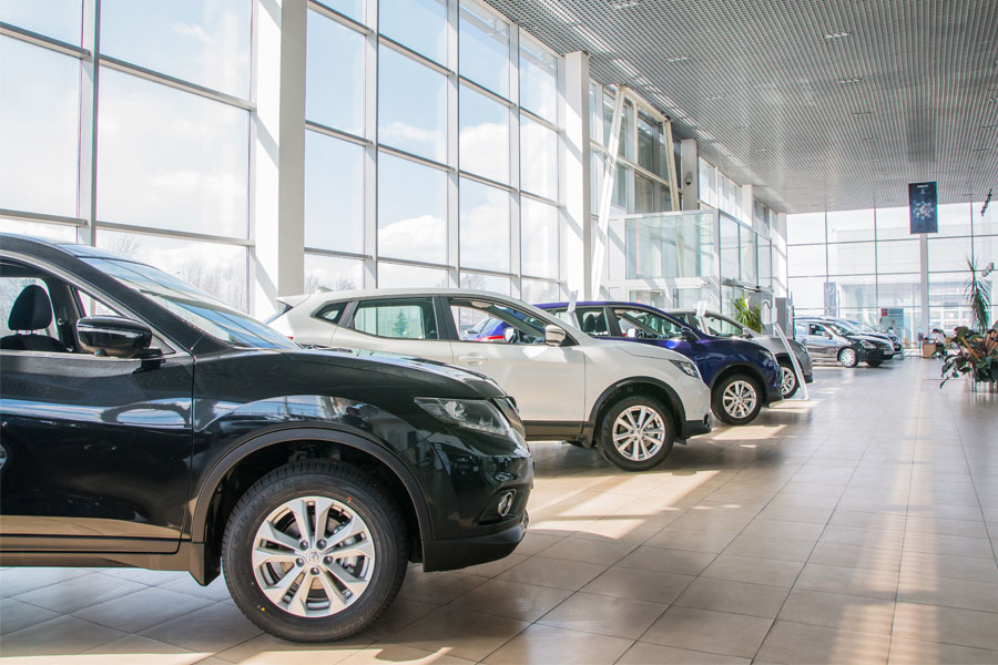 Car dealership with clean floors and large glass windows