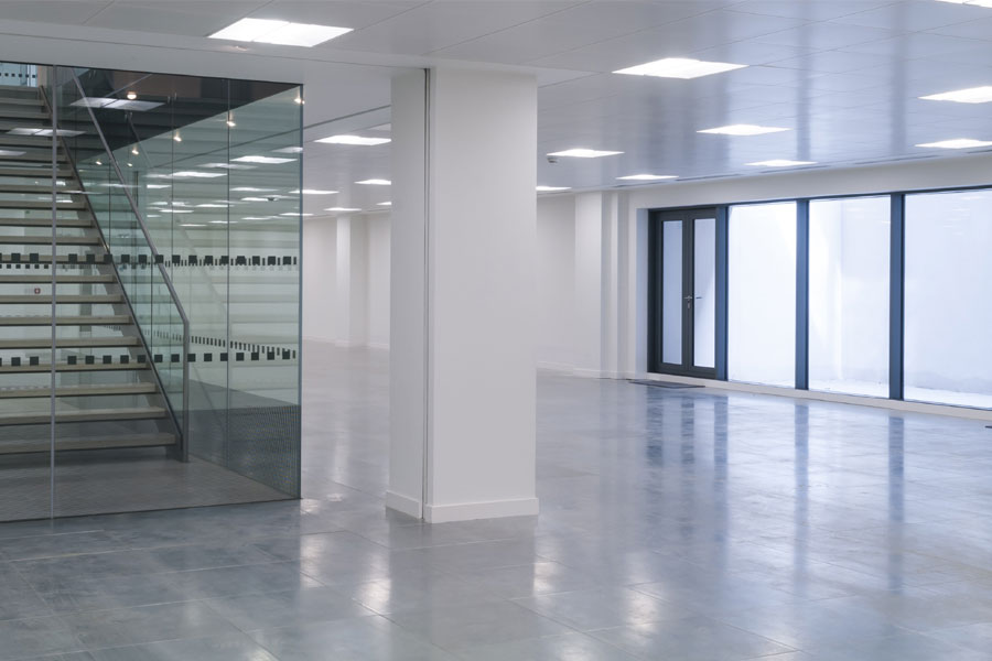 Commercial office building with glass windows and shiny clean floor