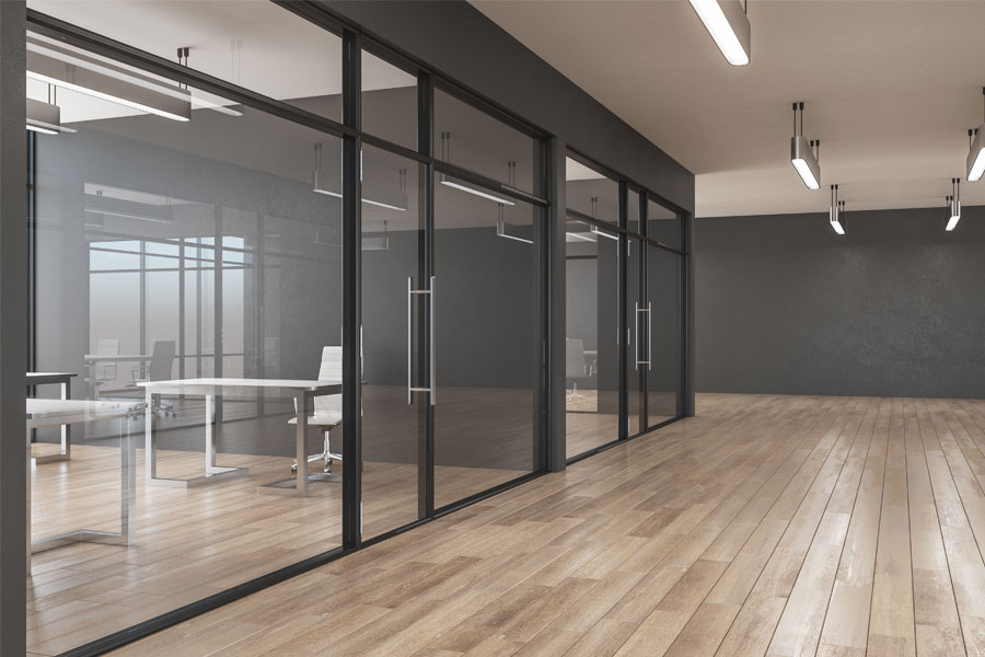 Modern clean office with hardwood floors and glass doors