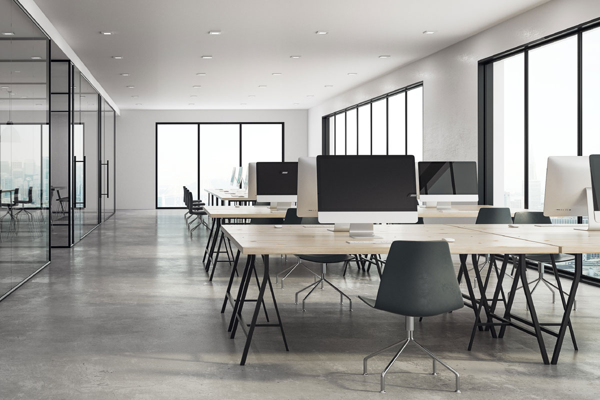 Clean modern office interior with wood desks and glass conference room doors