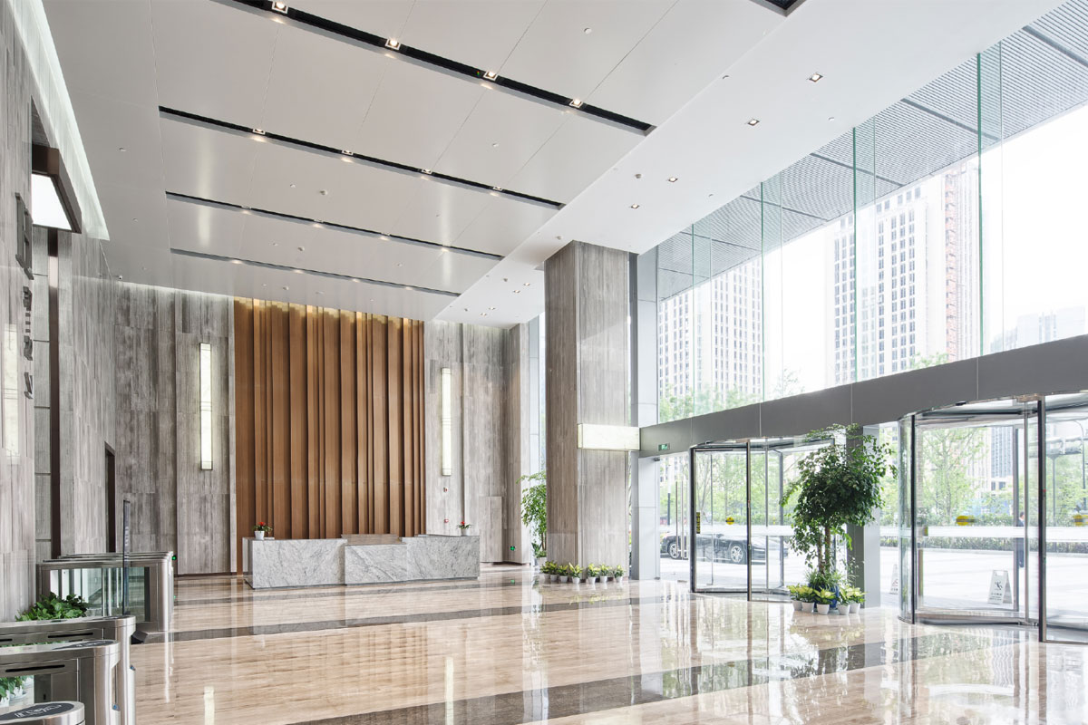 Clean office lobby with marble floors and glass front doors