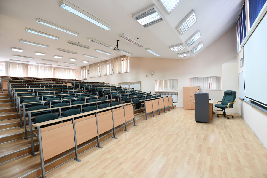 Clean auditorium classroom lecture hall with whiteboard and stadium seating
